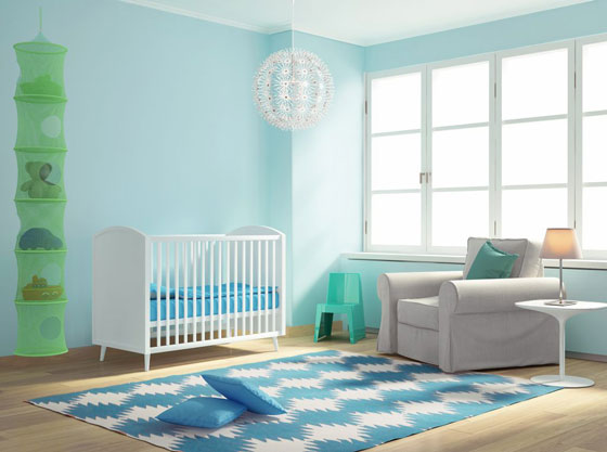 Blue green nursery with accent pieces