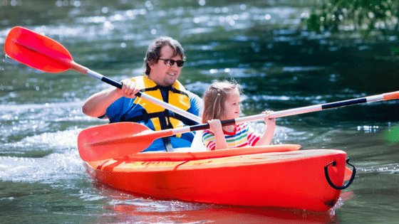 Paddle boating family outdoor activity