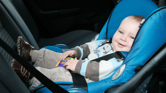 Child in car seat road safety