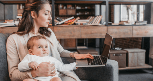 Mompreneur working on laptop with baby