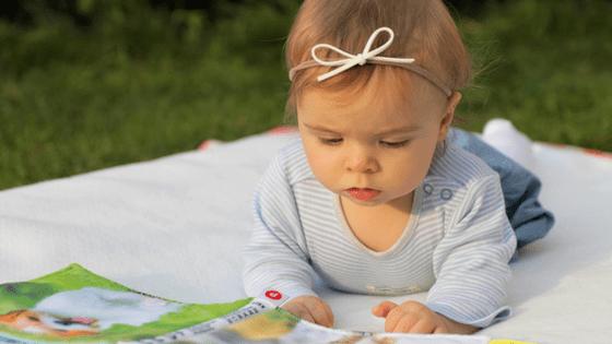 Toddler girl reading