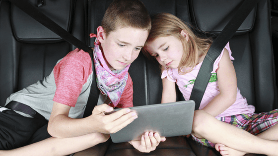 Kids Playing On Tablet In Car
