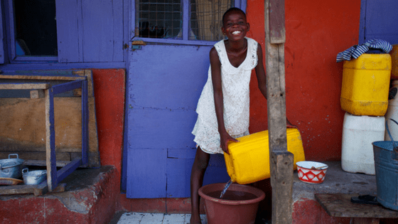 African Girl pouring Water