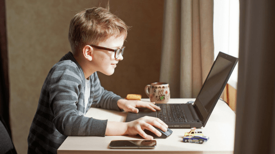 Boy working at laptop