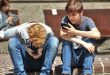 Teenage boys on phones