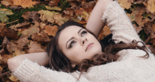 Beautiful woman lying on grass