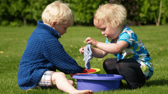 Children playing with cloths