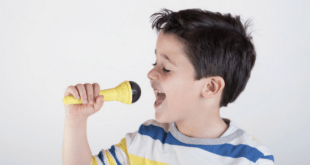 Little Boy Singing With Microphone