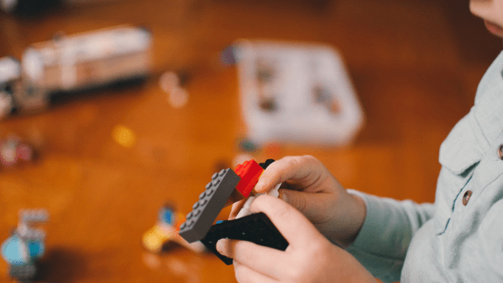 Little boy playing with Lego pieces