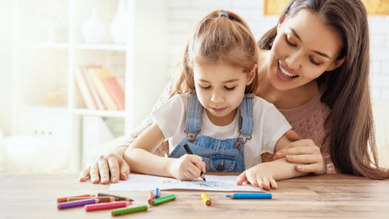 Little girl and mom coloring in pictures together