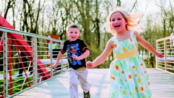 Children running over bridge