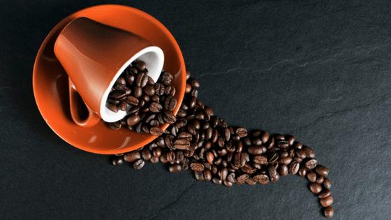 Coffee beans spilt cup