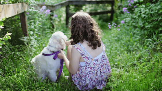 Girl with small white dog