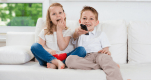 Kids watching tv with remote
