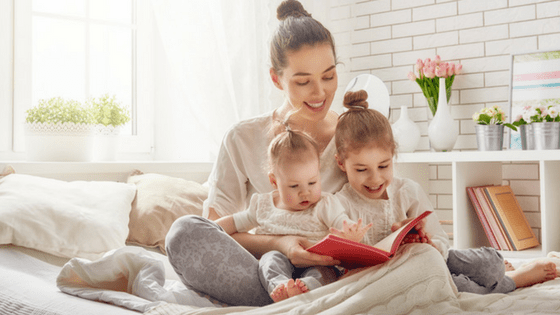 Mom reading to kids at home