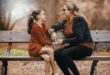 Mother and daughter talking on bench