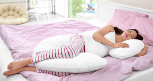 Pregnant woman sleeping with body pillow