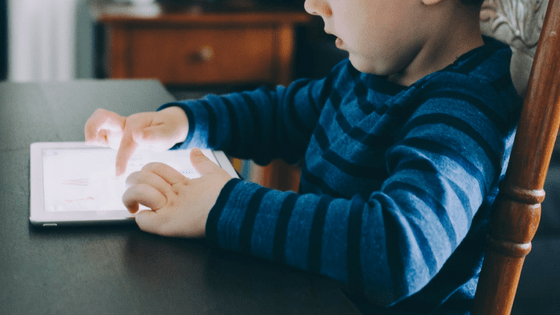 Boy learning on tablet