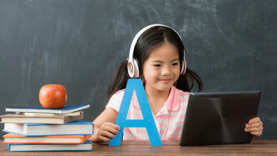 Child learning language skills on tablet