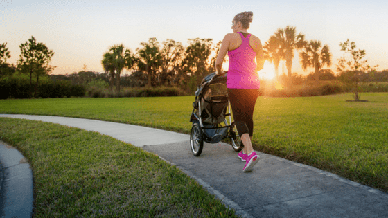 Mom jogging with baby stroller
