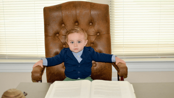 Toddler boy in office chair