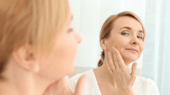 Woman applying facial cream