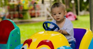 Boy sitting in ride on car