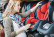 Mother to be choosing baby car seat