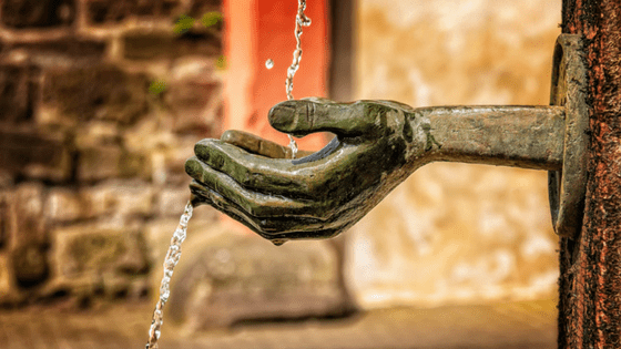 Water fountain with stone hands