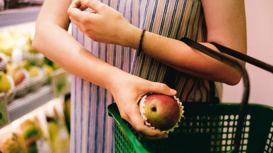 Choosing fruit at supermarket