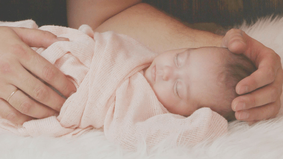 Newborn Baby Being Held By Dad