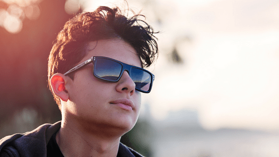 Teenage boy wearing sunglasses