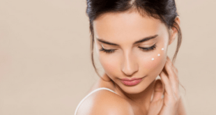 Young woman with lotion on her face