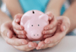Child holding piggy bank