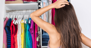 Woman standing in front of closet