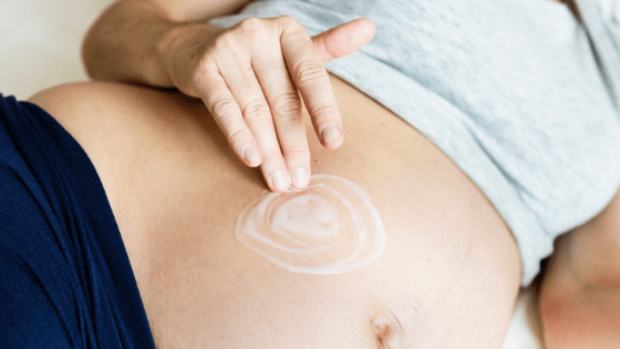 Pregnant Rub Cream Into Skin