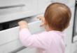 baby exploring kitchen cupboards