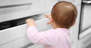 baby exploring kitchen cupboards