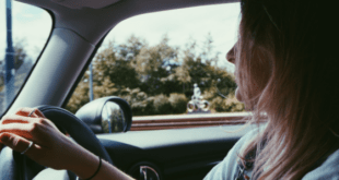 Teenage girl driving car