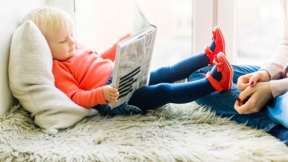 Young child reading book