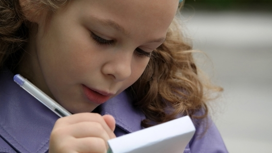 School girl taking notes