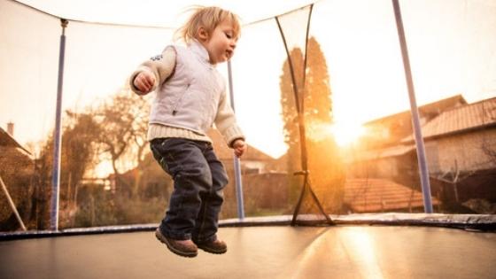 Toddler Boy Jumping on Large Trampoline
