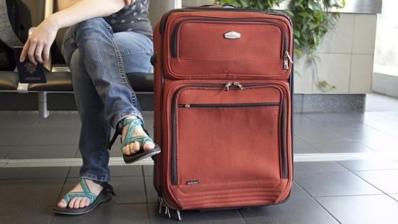 Waiting with bag at airport