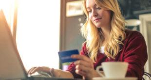 Woman spending online credit card