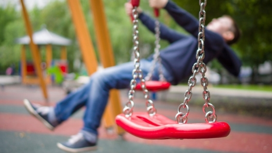 Child swinging playground