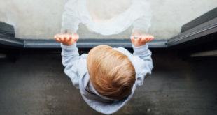 Toddler at window