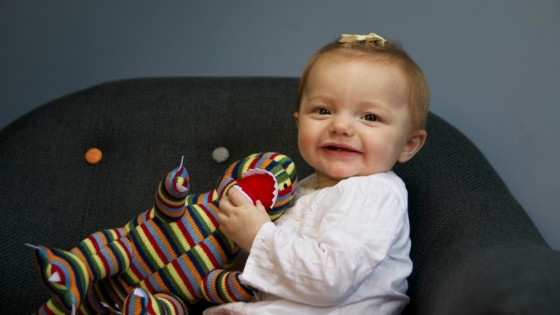 Toddler with stuffed toy