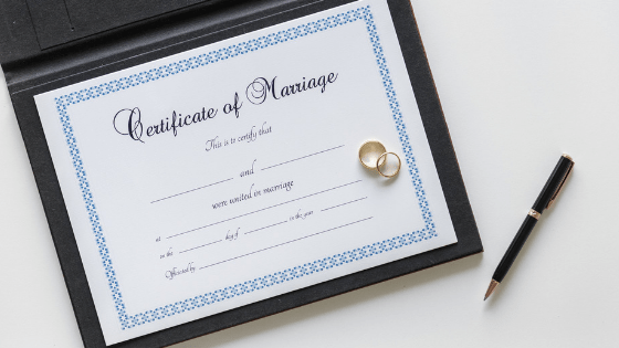 Marriage certificate and pen