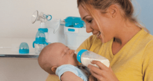 Mom bottle feeding newborn baby