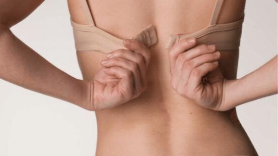 Putting on bra